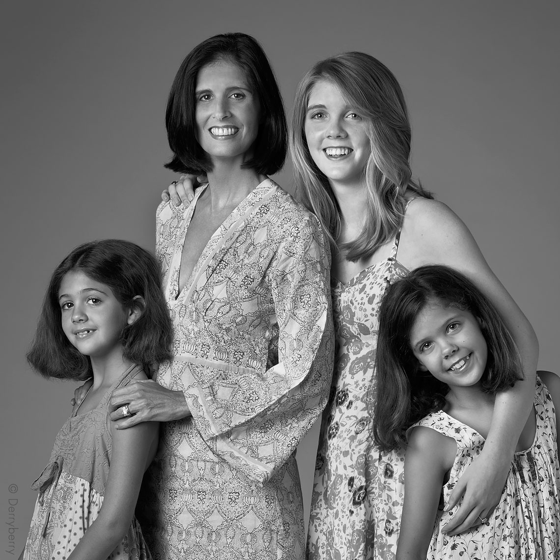 Black and white group portrait of the Horchow, Fearon, Pilsberry family girls in the studio  in Dallas, Texas by photographer John Derryberry Photography