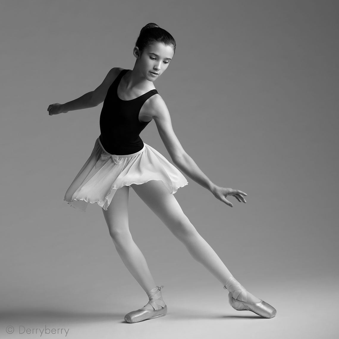 portrait of a young, tween ballet dancer in the studio in black and white in Dallas, Texas by photographer John Derryberry Photography