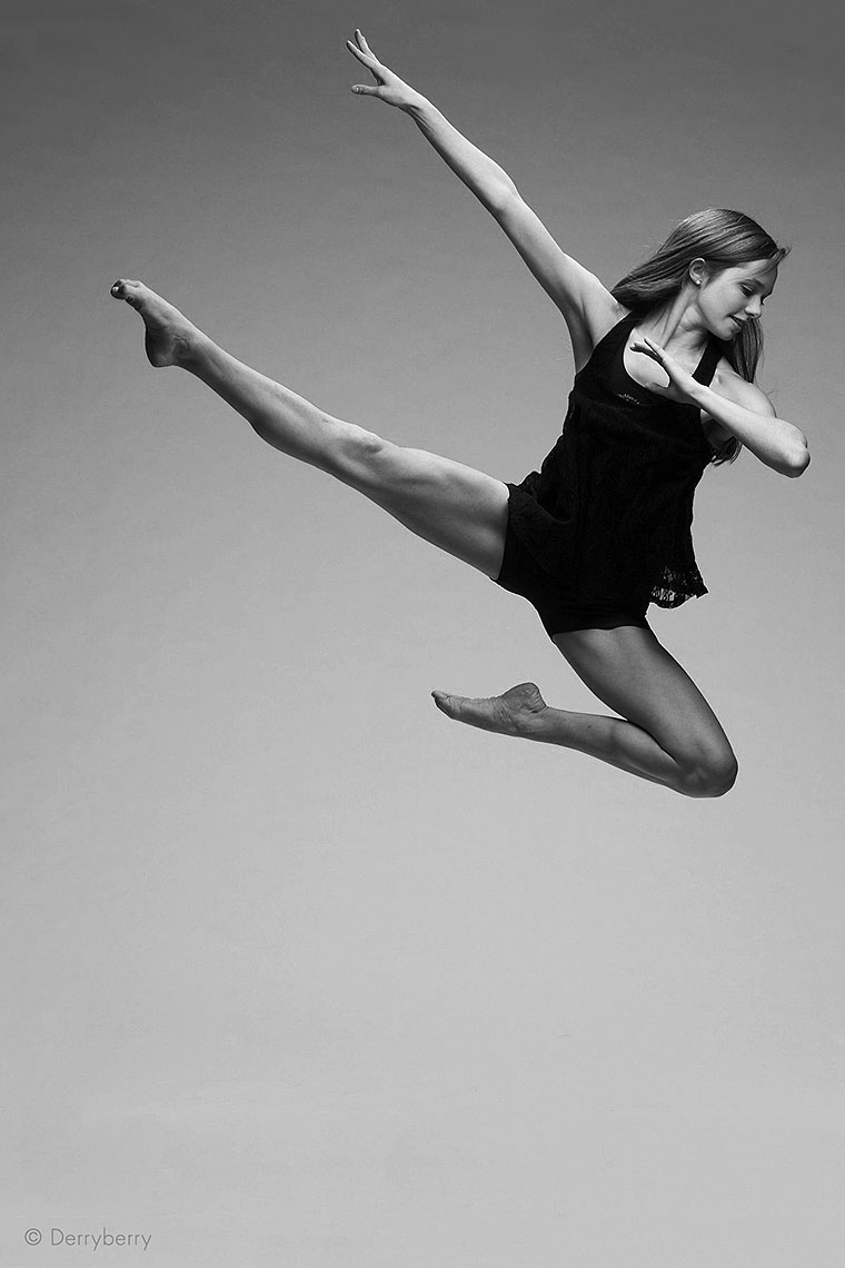 Black and white dance portrait of senior dancer Caroline Magee jumping in the air, from Highland Park, Texas