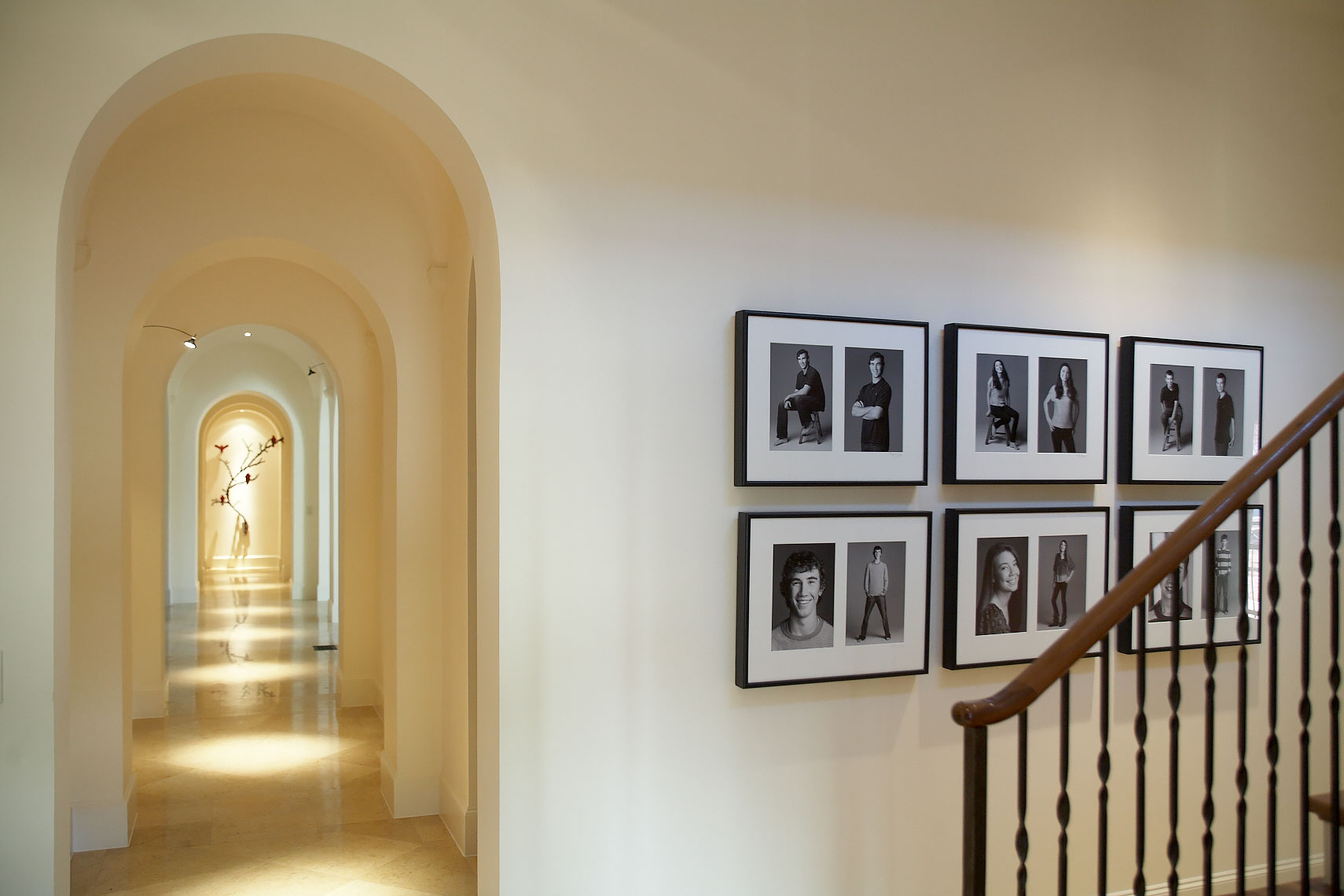 Vander Linden home gallery walls of a collection of portraits by Dallas, Texas photographer John Derryberry Photography