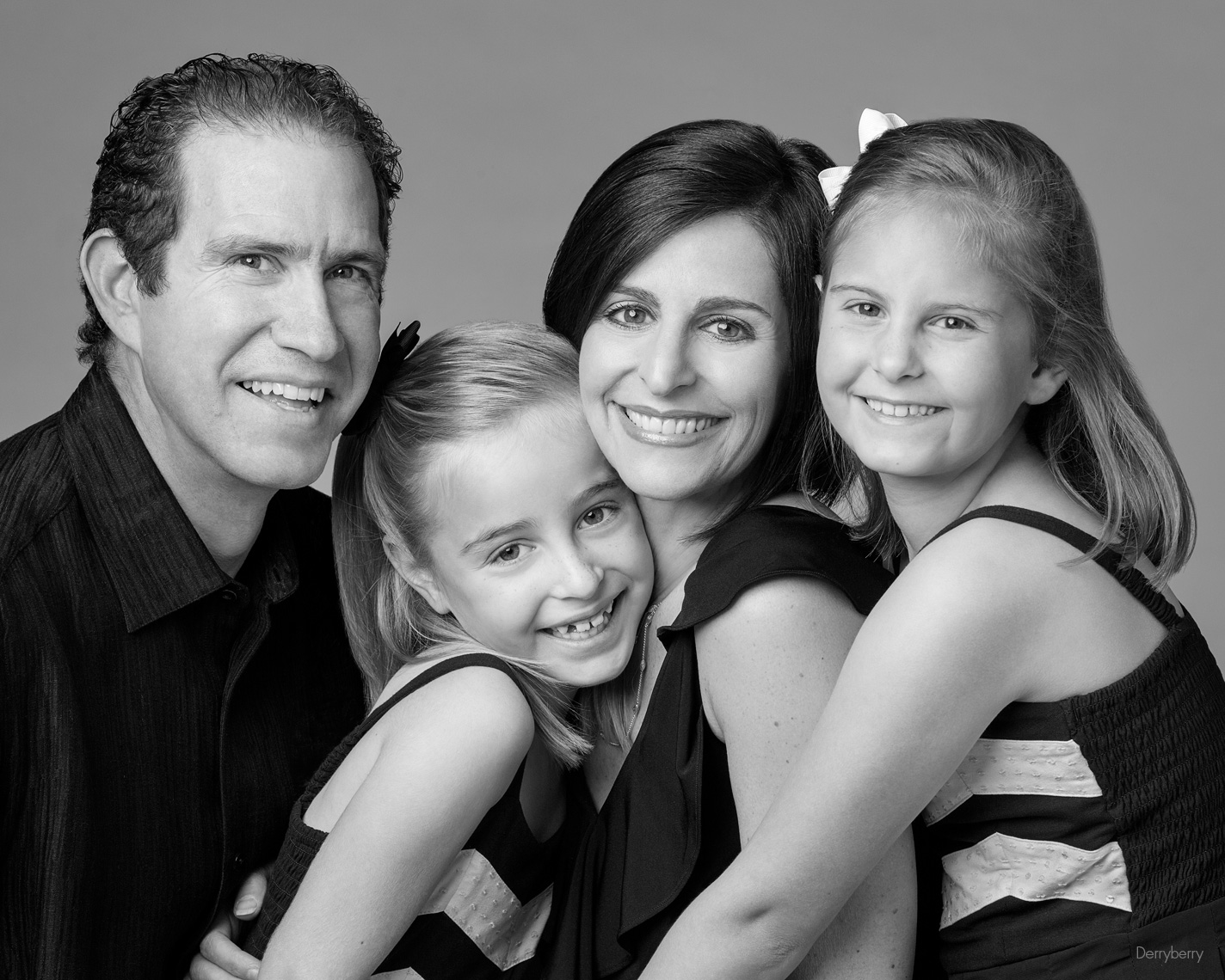 Black and white close-up  family group portrait of the Kronick family  in Dallas, Texas by photographer John Derryberry Photography