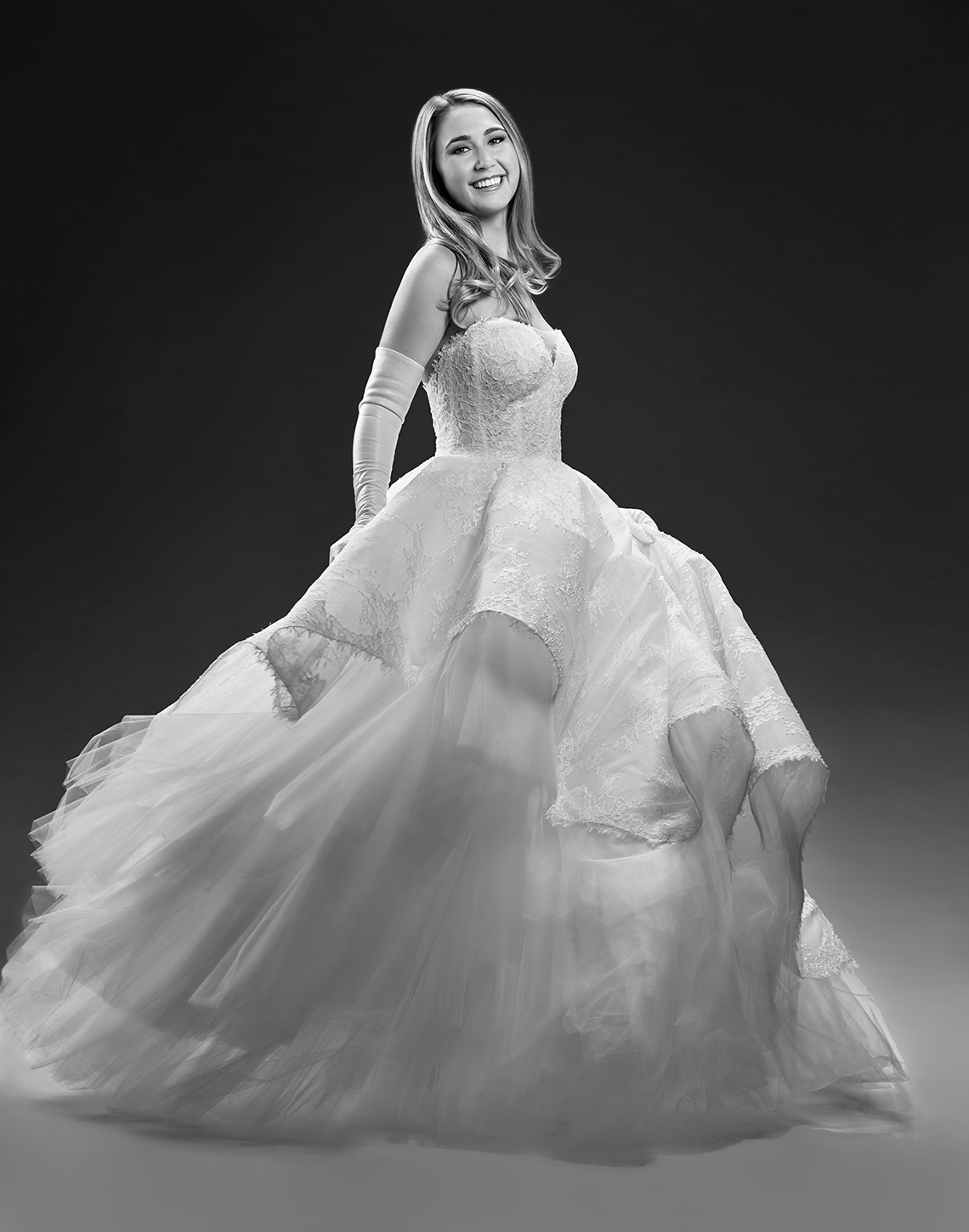 International debutant portrait of a girl swirling in her beautiful gown by John Derryberry