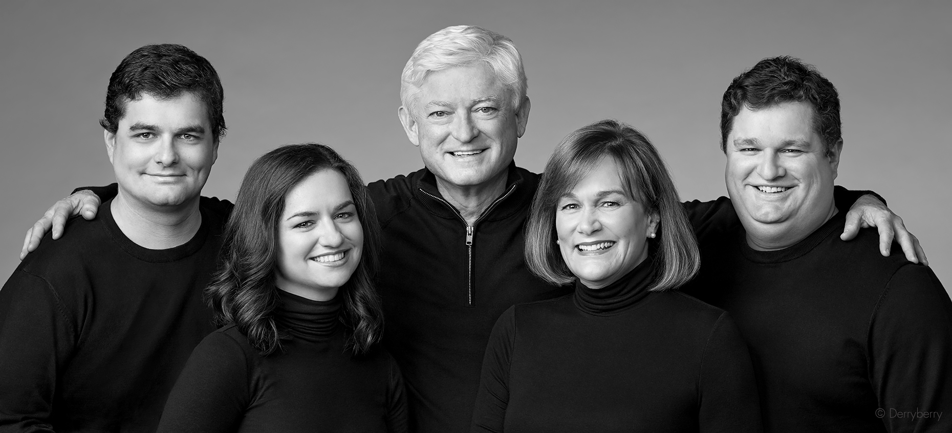 Close-up black and white studio group portrait of the Slack family in the studio in Dallas, Texas by photographer John Derryberry Photography