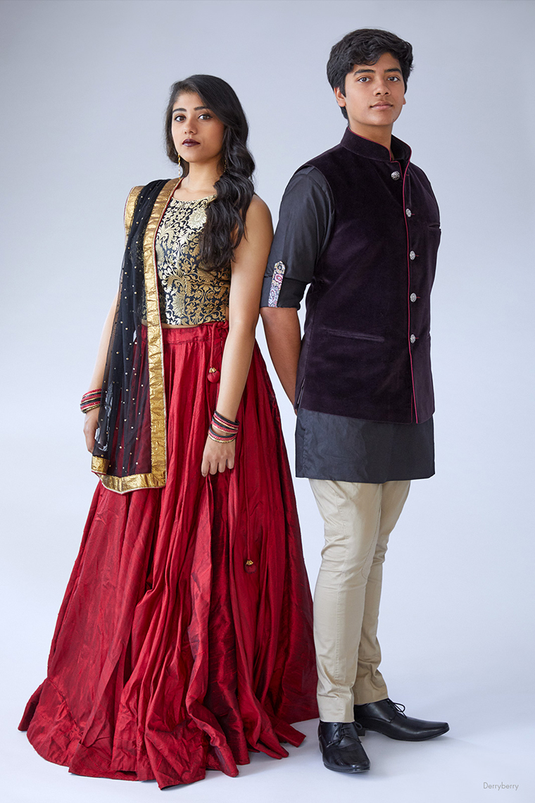 Senior portrait of Sudeep Bhargava with his sister Supriya in traditional Indian attire in the studio  in Dallas, Texas by photographer John Derryberry Photography