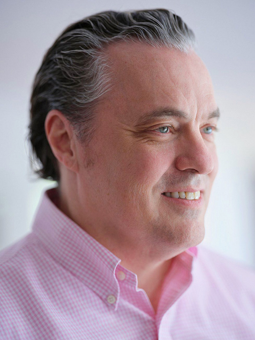 Michael Glassmoyer head shot portrait in a pink shirt  in Dallas, Texas by photographer John Derryberry Photography