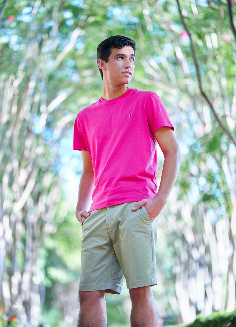Senior location portrait of Luke Contreras in a pink shirt from Greenhill School  in Plano, Texas by photographer John Derryberry Photography