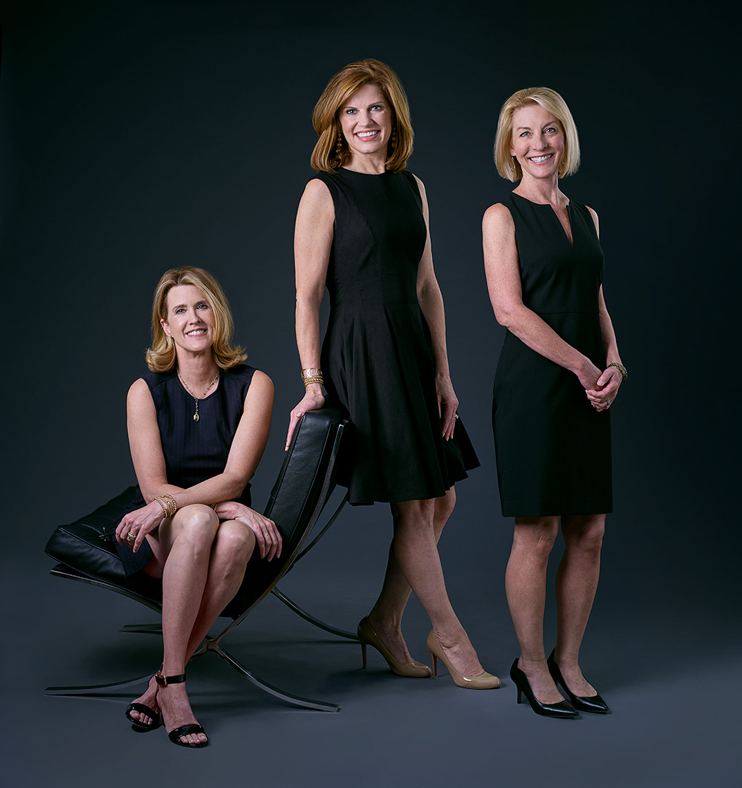 Group portrait of the Buford Muller Team from Briggs Reality in Dallas, Texas by photographer John Derryberry