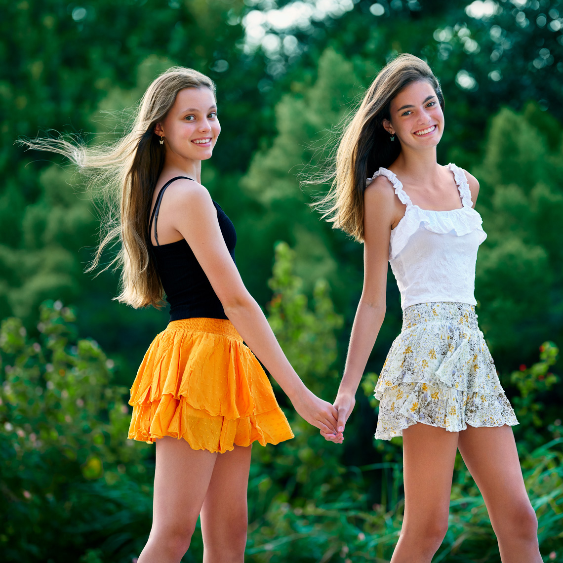 Portrait of ten sisters Lily and Lane Glassmoyer on location in Dallas, Texas, by John Derryberry Photography