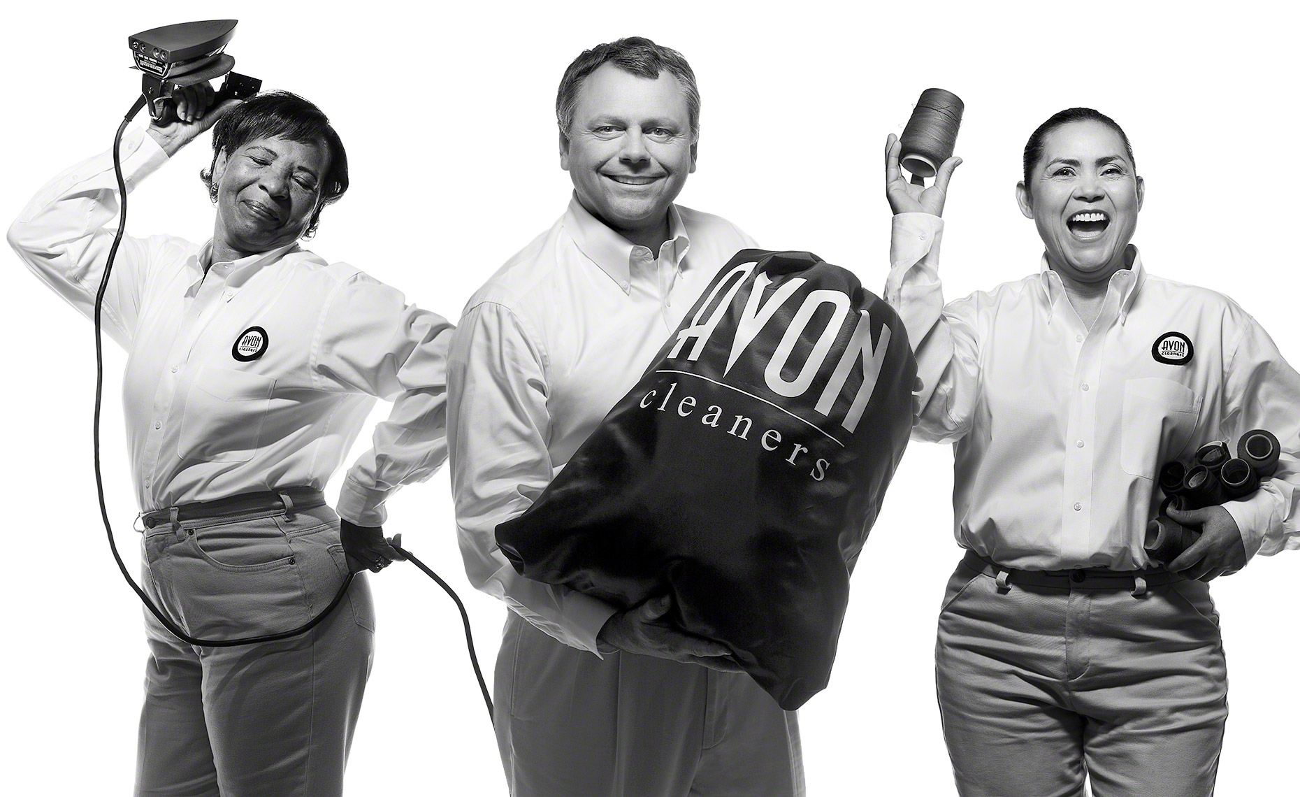 Black and white group business portrait for Avon Cleaners in Dallas, Texas by photographer John Derryberry Photography