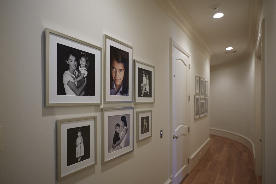 Beecherl home hall  wall gallery  collection of portraits by Dallas, Texas photographer John Derryberry Photography