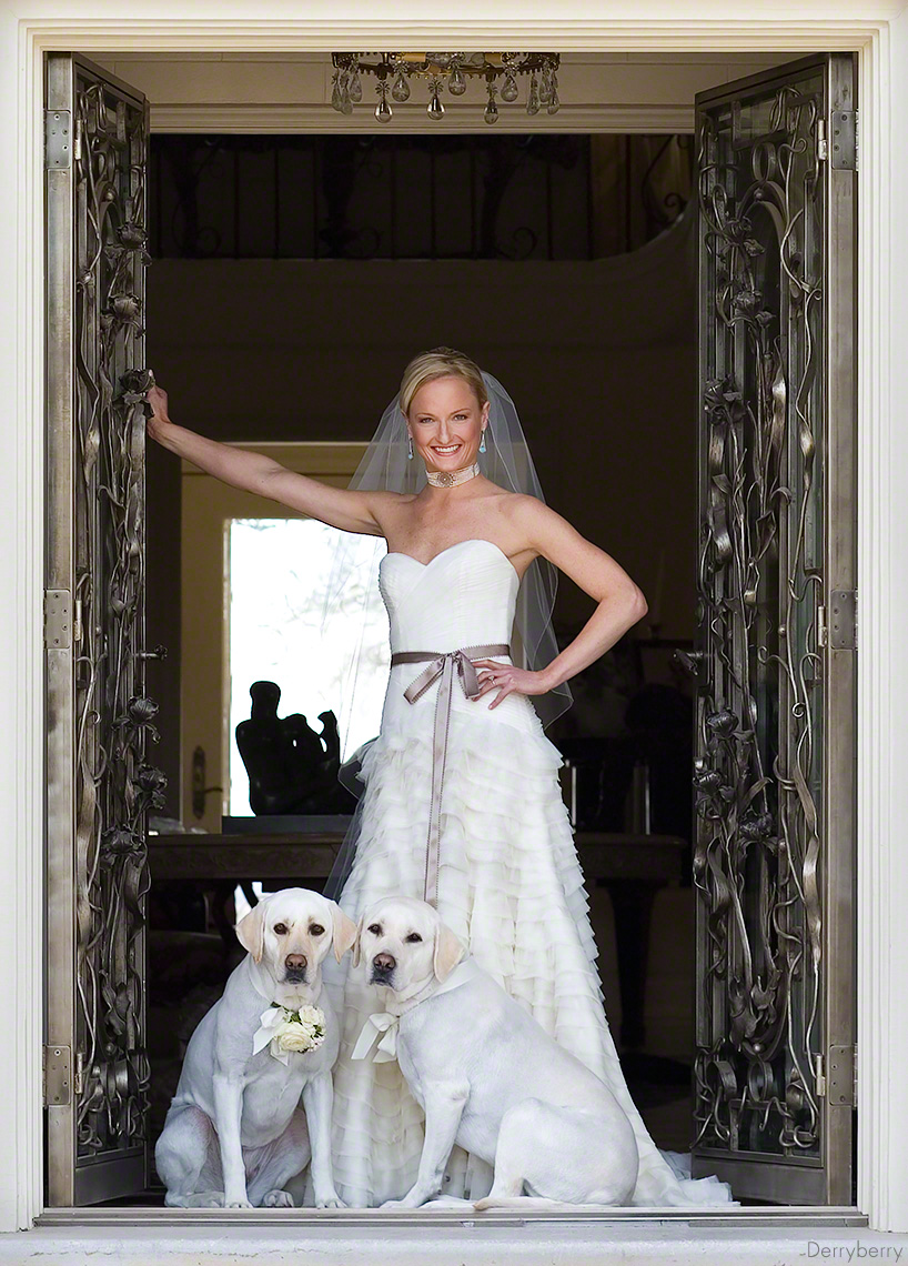 Ft. Worth bride Yost with her white labs standing I the doorway for a bridal portrait by John Derryberry