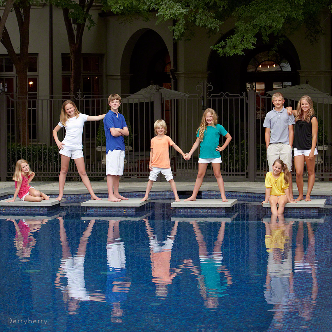 Dallas photography family portrait at swimming pool